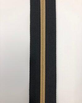 Bredare dragkedja i guld på svart botten, 6 mm